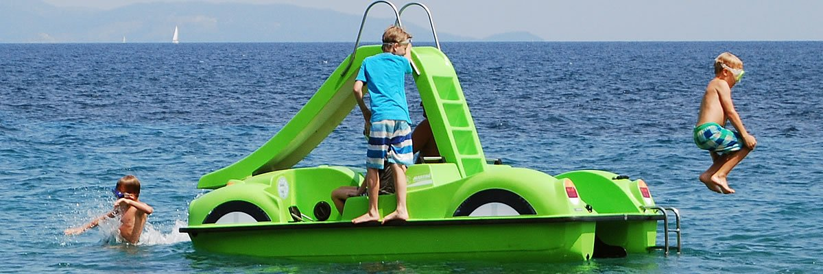 Pedalos for rent in Skiahtos . Our Green Pedalo ready for fun time